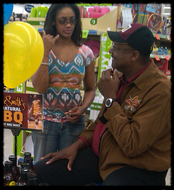 Elmore with daughter Tracy at a sauce demo